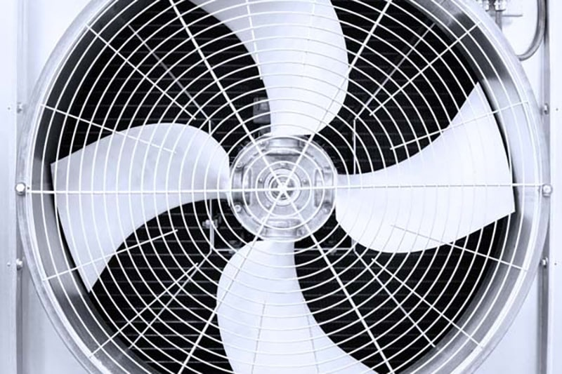 Close up image of an air conditioner fan showing the how it's important to know the components of your AC system.