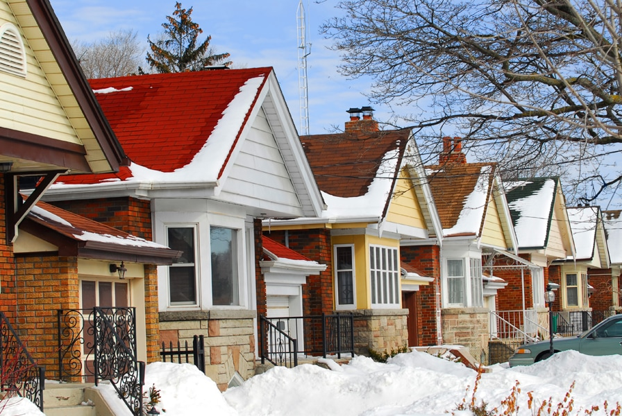 Row of residential houses in winter with snow, Prepping Your Plumbing for Winter
